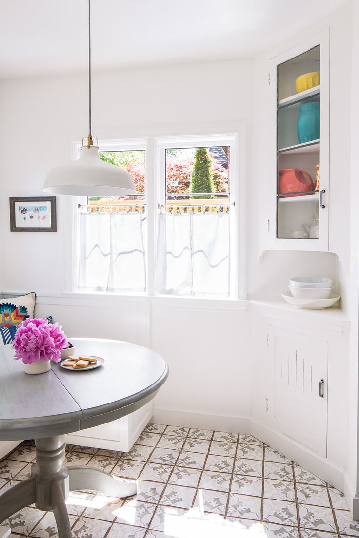 Built in kitchen nook - Dining Nook With Linen Cafe Curtains Built In Cabinetry Tabarka Tile Floors