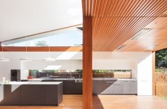 The kitchen runs through to the outside of the home, doubling as an outdoor kitchen
