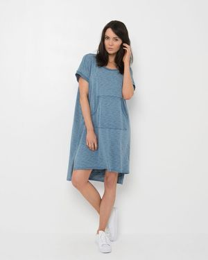 EM645 Tai Dress by ELLY M has a scoop neckline and short sleeves. This women's dress features a front slide pocket and an easy fit with a hi-low hemline finishing approximately just above the knee at the front and below the knee at the back. Comes in denim look Cotton.
