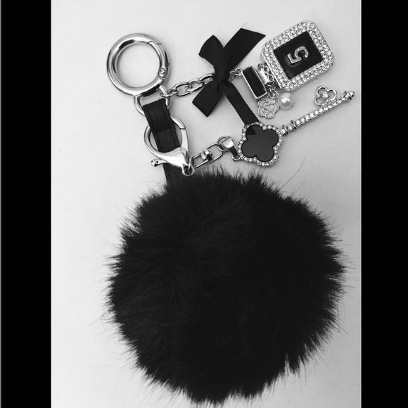 Fluffy Fur Black Pom Pom KeyChain with Charms Gorgeous Fluffy Fur Black Ball keychain Embellished with silver rhinestone perfume bottle with flower & pearl Along with silver rhinestone key charm and bow Great bag ornament *purses not included Accessories Key & Card Holders