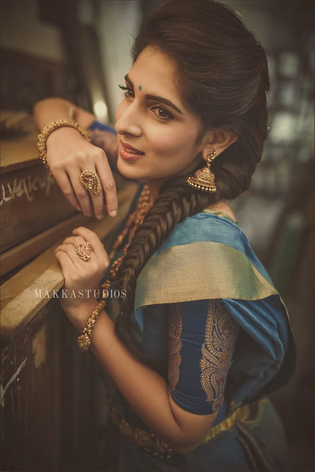 South Indian bride. Temple jewelry. Jhumkis.Blue silk kanchipuram sari.Fishtail side Braid. Tamil bride. Telugu bride. Kannada bride. Hindu bride. Malayalee bride.Kerala bride.South Indian wedding