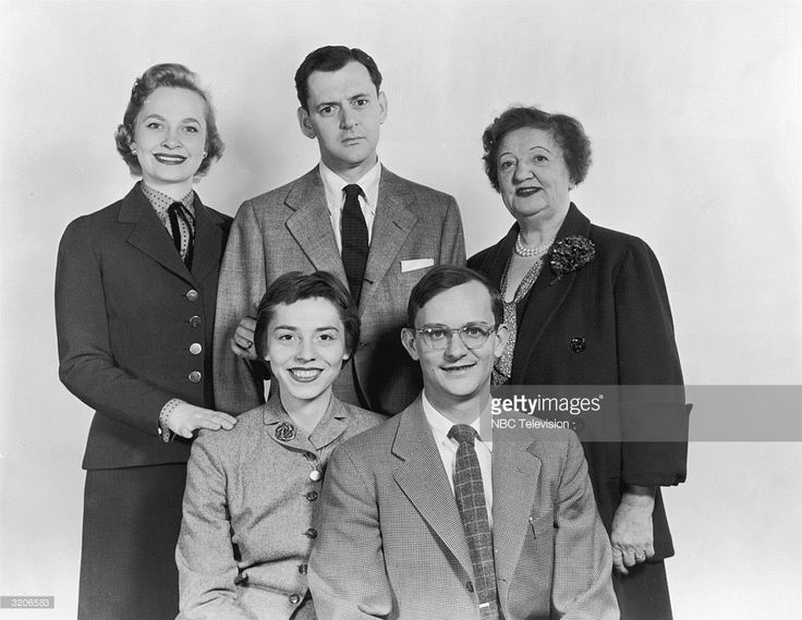 1953: The cast of the television series 'Mr. Peepers' pose for a promotional portrait. L-R: (seated) Pat Benoit, Wally Cox, (standing) Georgiann Johnson, Tony Randall, and Marion Lorne.