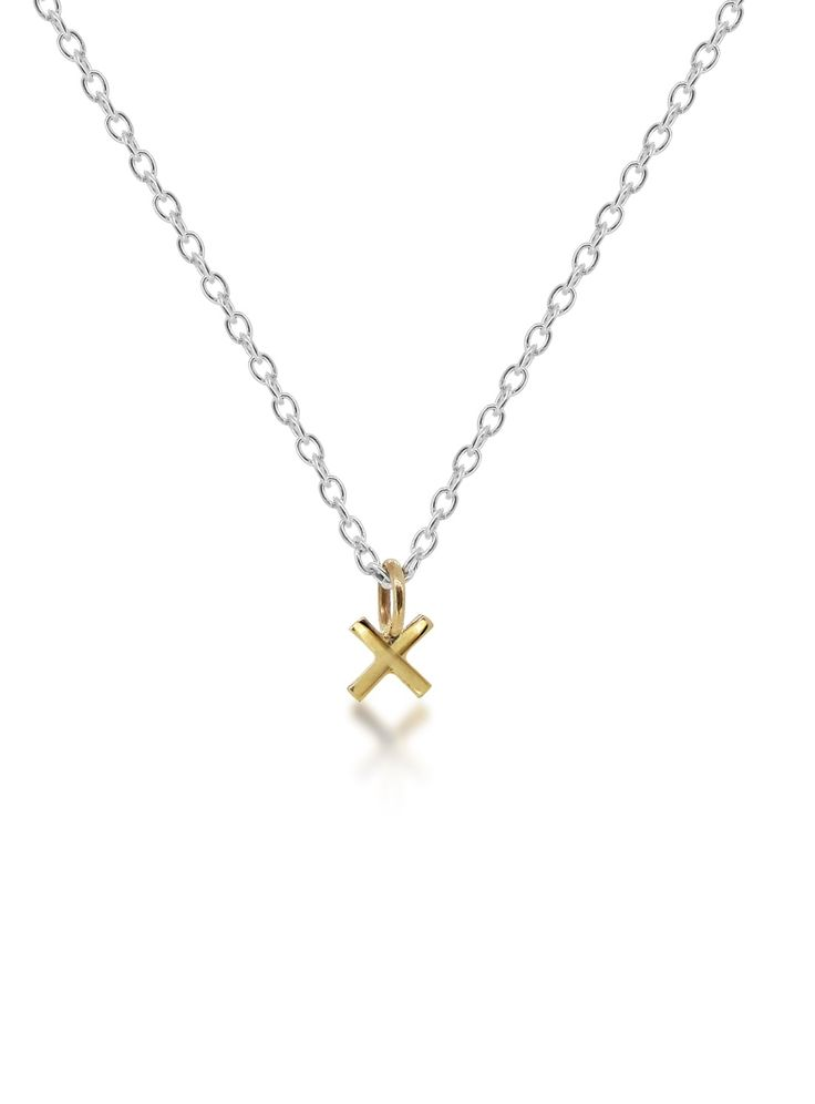 "We love the way Maya Magal mixes gold and silver to remain entirely minimal yet truly distinct. This simple ""Kiss"" pendant is a perfect gift to wear each and everyday as a signature piece."
