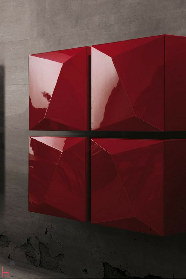 Prisma is a wall cabinet by Linfa Design with one door, lacquered in a glossy red shade.