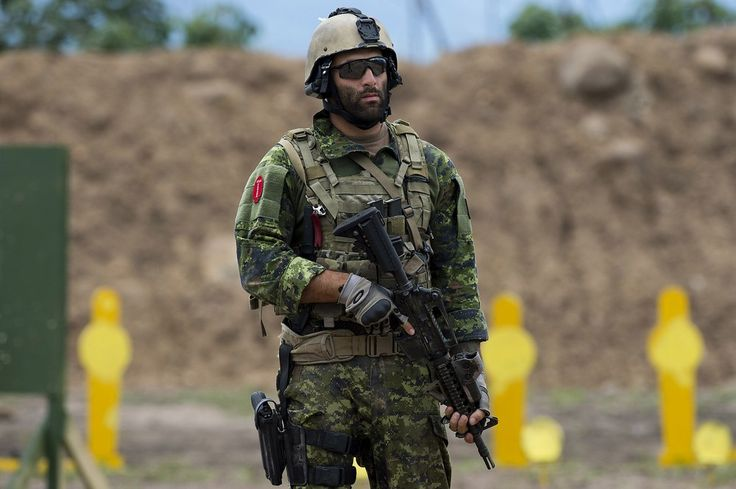 A Canadian special forces soldier stands by to take part in the assault teams event of the 9th edition of the commando forces competition at the military base of Tolemaida, Colombia on June 9, 2012. Elite troops from 21 American countries take part in the competition.