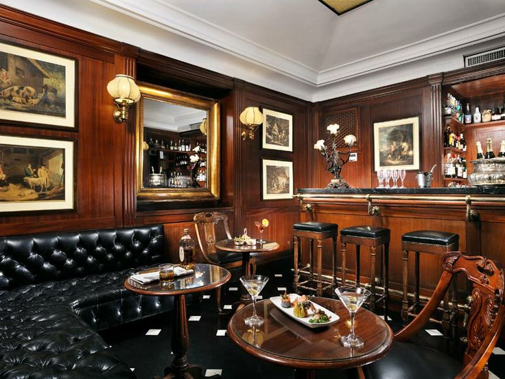 "Bond Bar - Royal Demeure Hotels. Look at all that gorgeous old wood panelling. Just the place for something ""shaken, not stirred""."
