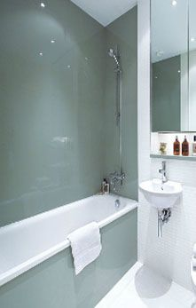 Glass Splashbacks. Thinking about doing this in our bathroom.