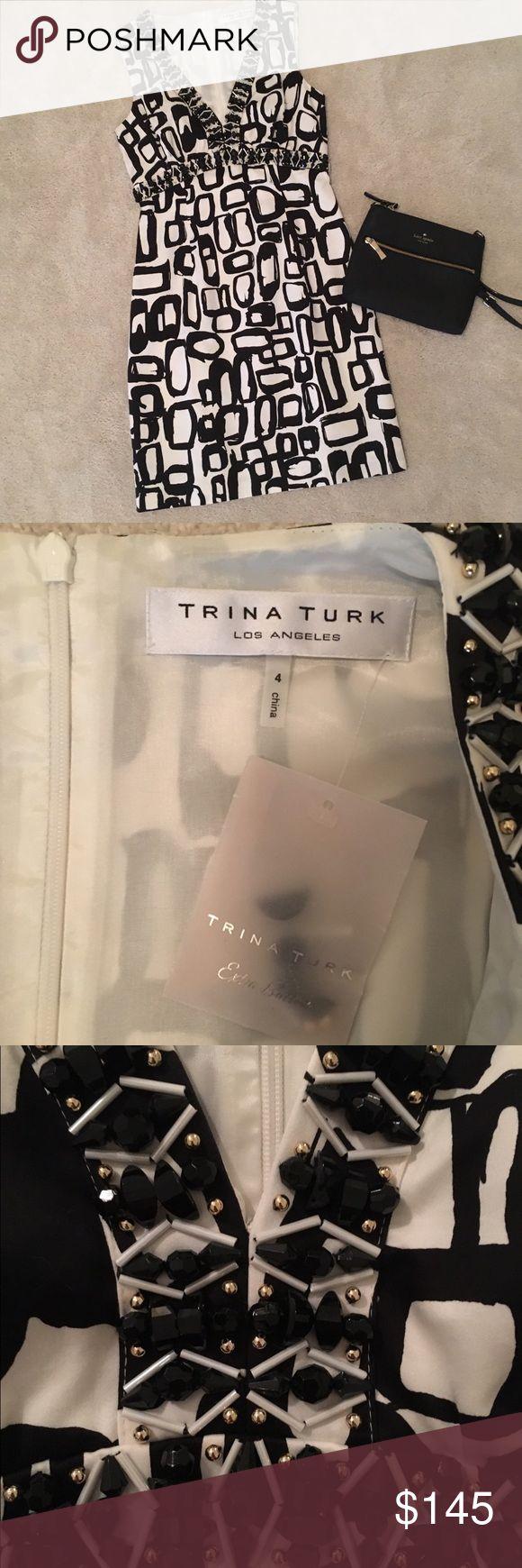 NWT Trina Turk geometric print dress size 4 NWT Trina Turk geometric print dress size 4. V-neck for a flattering shape with a zipper up the back. Beautiful beading on the neck line. 75% cotton, 25% silk lining Trina Turk Dresses Midi