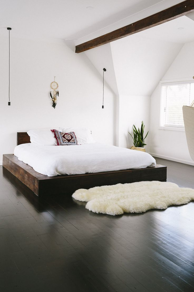 Simple bedroom with lofted ceilings hardwood floors