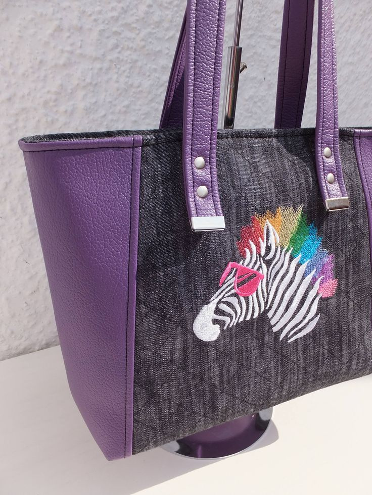 Zebra Tote Bag, Denim and Faux Leather, Purple and Black Machine Embroidered Bag, Handmade, Gift for Wife, Christmas Gift, One of a Kind by BobbinsFullofThread on Etsy https://www.etsy.com/uk/listing/557124599/zebra-tote-bag-denim-and-faux-leather
