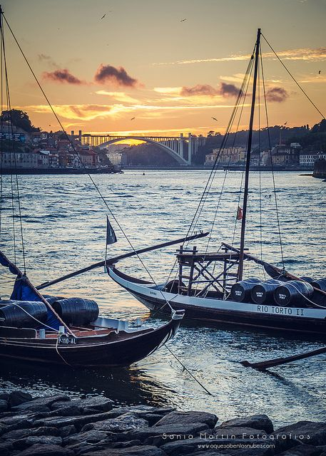 Oporto Rebelo boats transporting Port Wine down the Douro River #Portugal