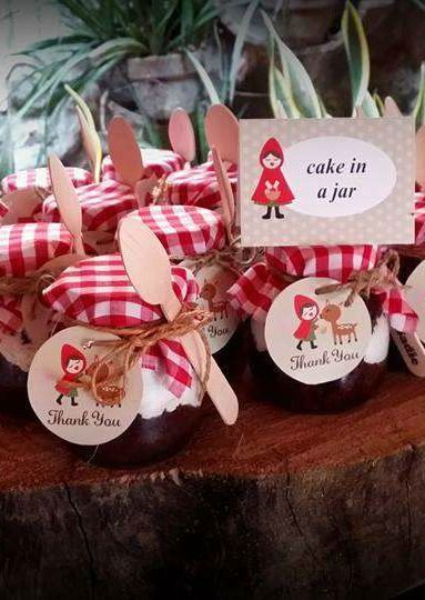 Cake in a jar favors at a Little Red Riding Hood birthday party!  See more party planning ideas at CatchMyParty.com!