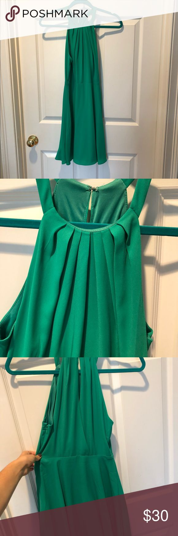 Express green fit and flare cocktail dress Express size 2 fit and flare spring green (brighter than it looks in the photos) day to night dress. High neck styling with pleats on the chest. Super flattering and fun! Only selling because I've grown out of it :). 100% Polyester. Fits true to size. Express Dresses Mini