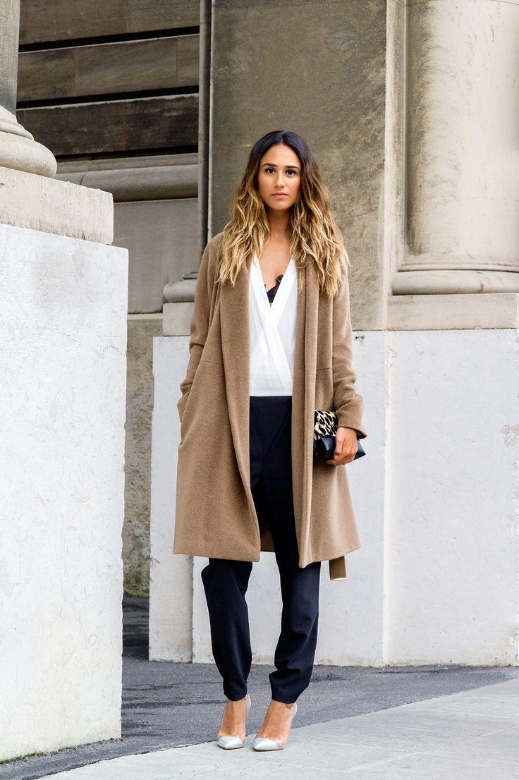 Soraya Bakhtiar's minimalist style mixes Tibi's Tropical Wool Jumpsuit with a tan overcoat.
