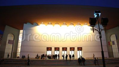National Theatre Ion Luca Caragiale in Bucharest, Romania night - people coming to entry.