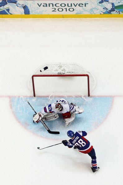 Ilya Bryzgalov and Pavol Demitra Photos - Ice Hockey - Winter Olympic Games 2010 - Vancouver