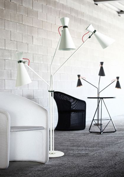 Simone standing lamp has a unique sculptural and charismatic shape. This lamp's  asymmetric body is handmade in brass and the lampshades in aluminium. It's a versatile lamp which gives a sophisticated and joyful ambiance to any living room or bedroom.