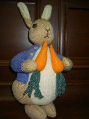 Summary Peter is shown with a handful of radishes and still wearing his little blue coat, but no longer wearing any shoes. He is worked in many small pieces and then assembled. His jacket and the radishes are permanently attached. All facial features are embroidered.