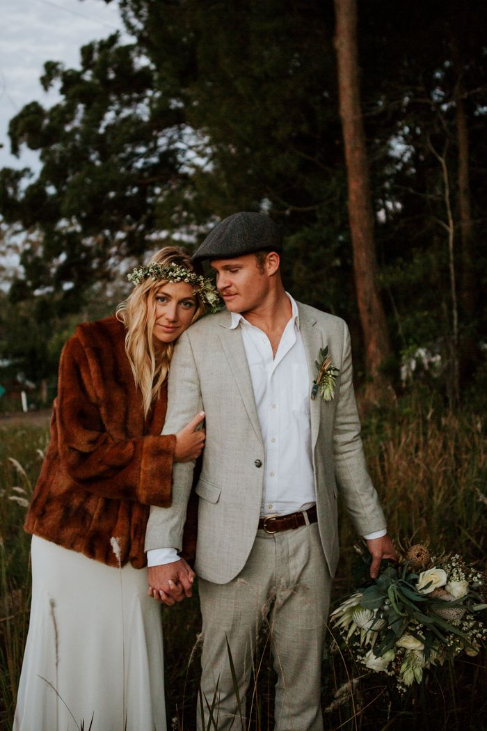 This trendy bride added a spice of pretty + posh w/ a fur jacket | Image by Amy Higg Photography