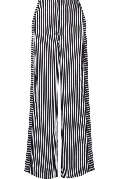 Elizabeth and James' wide-leg pants are made from inky midnight-blue and white crepe. Cut to sit high on the waist, this pair has strategically placed vertical and horizontal satin stripes that elongate your frame. Style them with a solid colored top or mix it up with a patterned top.