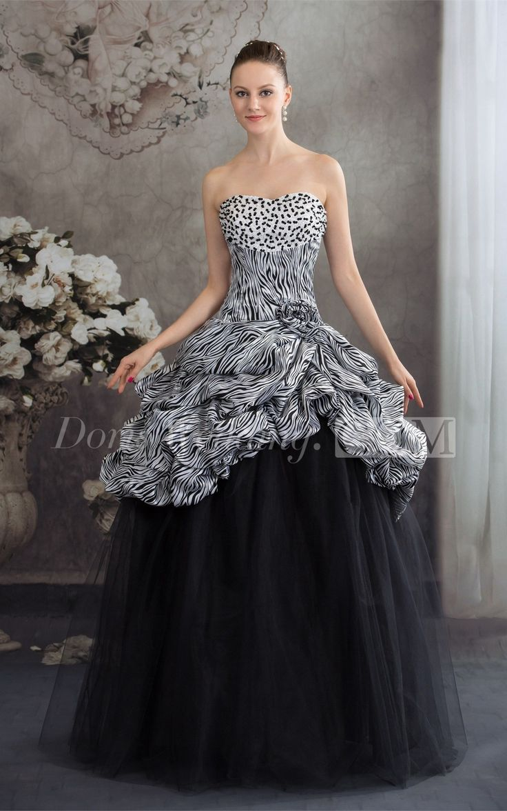Sleeveless Zebra Print Jeweled Top And Ball Gown With Flower