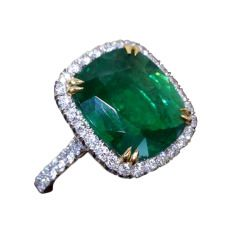 Beautiful Cushion Cut Green Emerald Diamond Platinum Ring, A beautiful cushion shape natural emerald weighing 7.06 carats set in a handmade platinum mounting with 1.12 carats of colorless vs clarity round brilliant cut diamonds.