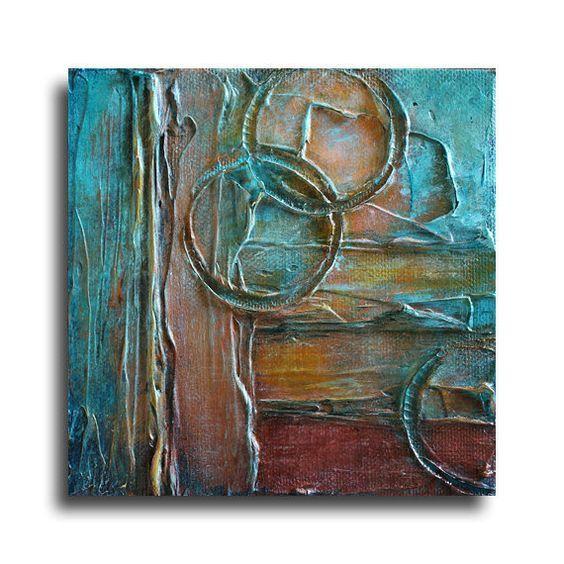 Originele Abstract Schilderij door Marie Bretz - tinten van Turquoise, Brown, roest, gouden Amber geel en wit.   TITEL: CHRONOLOGIE IK  GROOTTE: Één (1) - 5 x 5 x 7/8  MEDIUM: Acryl op Canvas  KLEUREN: Tinten van Turquoise, Brown, roest, gouden Amber geel en wit.  ZIJDEN: Gallery gewikkeld zijden zijn zwart geschilderd. READY komt te hangen.  Elk schilderij is ondertekend op de rug door Marie Bretz  Uw object zal worden verpakt en verzonden met zorg via USPS Priority Mail   OVER DE…