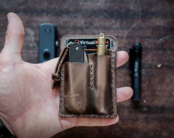 The H&T Card Caddy is a simple yet effective way to ensure you are prepared for the day ahead. This handcrafted leather wallet with pen and pocket knife holder is made to order. Cut, stitched, & burnished with great care by human hands. Crafted with 5oz American tanned Wickett & Craig leather, one of the last specialty tanneries in the country, this exquisite & durable leather will not only endure but get better with age. Fits: (1-6) cards (1) Small Pocket Knife (ie: Swiss Army ...