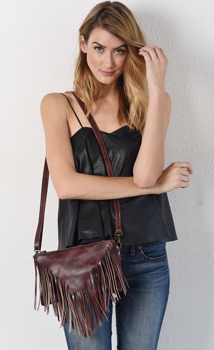 Fringe bags are really on trend right now especially for festival season. Perfect to match that coachella outfit. The Scarlett color pops with any spring outfit. This BEDSTU cross body is hand made and created with organic leather