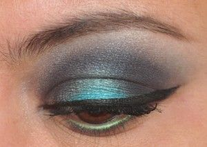A pop of turquoise in a smoky blue lid.
