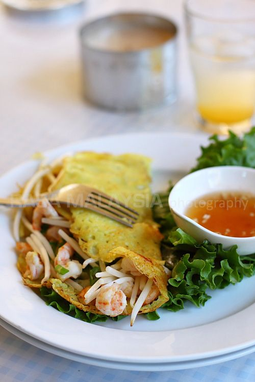 Vietnam - Banh Xeo Recipe (Sizzling Saigon Crepes) - Vietnamese coconut crepes with pork, shrimp, and bean sprouts