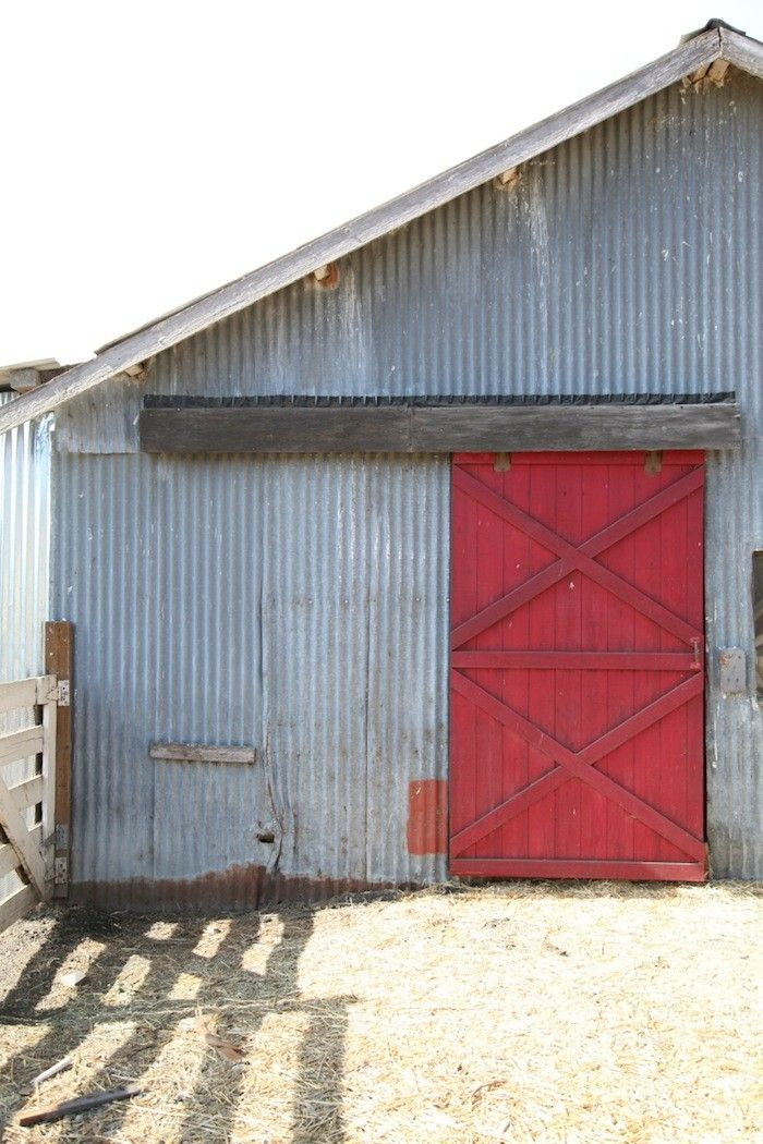 Corrugated Metal Barn With Red Barn Door Facades