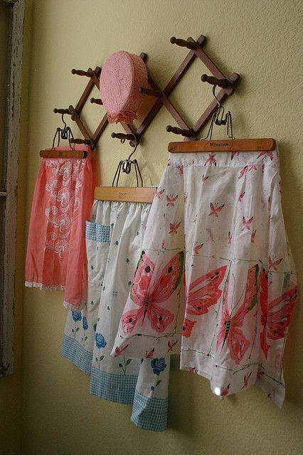 Repurpose and upcycle a vintage coat rack.  Use it to display a vintage linen collection.  I would paint it pink, white or green. Hang jewelry???