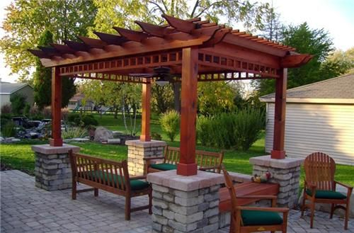 This crisp wooden pergola fits into the surrounding greenery yet has a clean design which invites visitors outdoors. Designed by Breckenridge Landscape in New Berlin, WI.