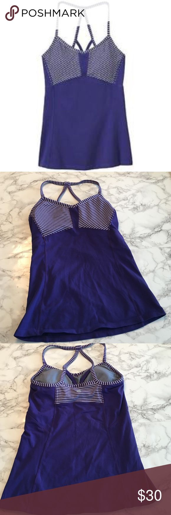 """Athleta Striped workout top in purple Athleta Striped Workout top in Purple. Size small. Purple with white stripes. Spaghetti. Strap, racerback workout top. Has padding. In gently worn, preloved condition with no imperfections. I DO NOT MODEL LISTINGS, measurements approx. 18.5"""" length, 12.5"""" across the bust. Love the item but not the price? Please make offers using the offer button. 🚫POSH ONLY, NO TRADES OR COMMENT OFFERS🚫 Athleta Tops"""