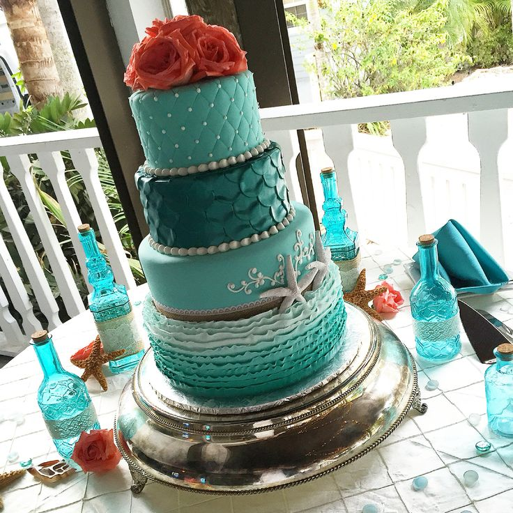 Little mermaid wedding cake! Turquoise green and coral for a beach-themed wedding on the water.  Cake by Anna Cakes. annacakes.com