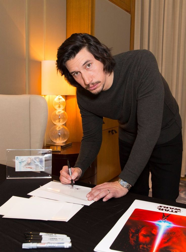 Adam Driver autographing limited edition Star Wars note