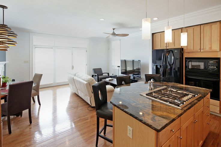 The Open Kitchen Features An Island W Thermador Gas