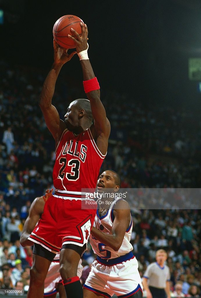 Michael Jordan #23 of the Chicago Bulls pulls down a rebound in front of Darrell Walker #5 of the Washington Bullets during an NBA basketball game circa 1989 at the Capital Centre in Landover, Maryland. Jordan played for the Bulls from 1984-93 and 1995 - 98.