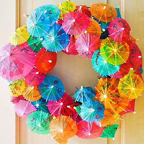 A wreath of drink umbrellas creates an exotic, islands feel via Party City