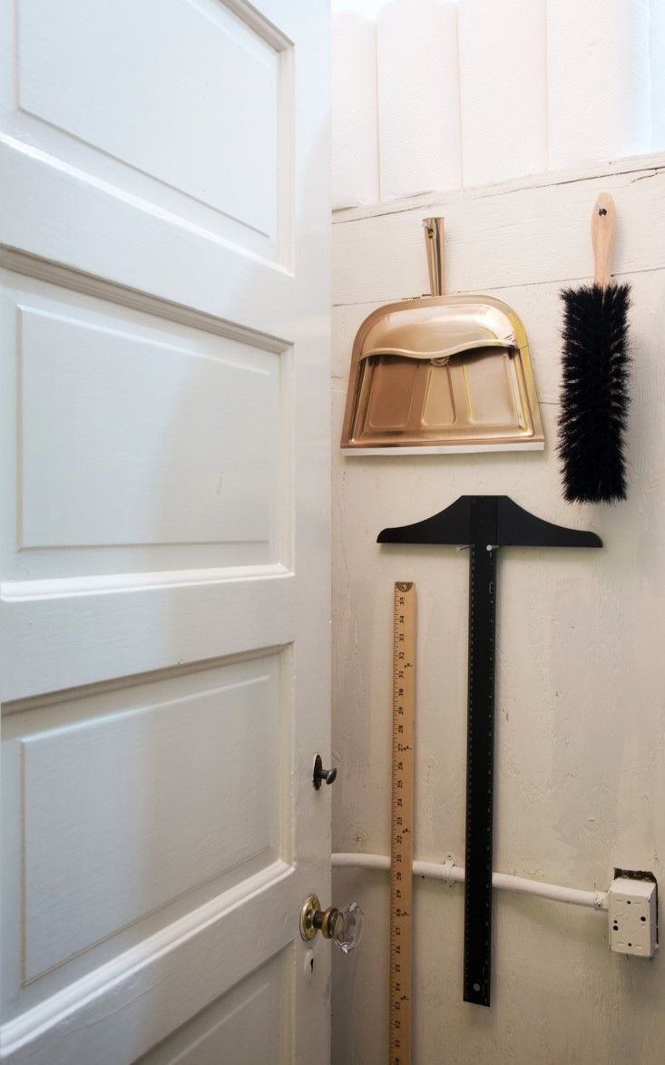 How to hang your brush, dustpan, T-square, and yard stick in a pleasing assemblage