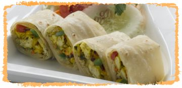 Yogi Vegetarian Wrap ... loaded with chick peas, avocado, tomato, cucumber and salsa, wrapped up in one big serve of lip-smacking perfection and served with fries.
