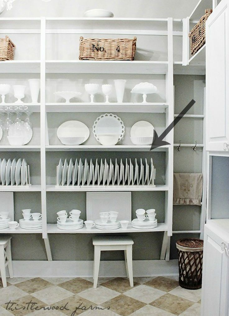 Mimic a built-in plate display shelf by stacking extra-tall plate display racks end-to-end and adding a bit of paint. Get the tutorial at Thistlewood Farms.   - CountryLiving.com