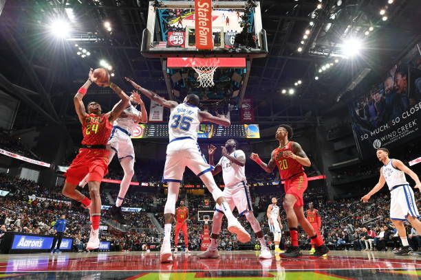 Kent Bazemore of the Atlanta Hawks handles the ball against the Golden State Warriors on March 2 2018 at Philips Arena in Atlanta Georgia NOTE TO...