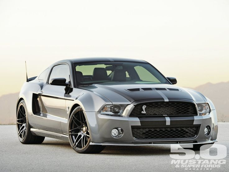 Silver Ford Mustang with black racing stripes.