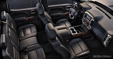 Interior photo of the spacious and luxurious GMC Sierra Denali pickup truck.