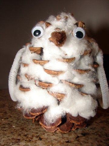 Owl made out of a pinecone and cotton balls. Also use a pine cone to make a bird feeder. Roll cone in egg whites then sprinkle with seeds. when dry, tie ribbon at top to hand.