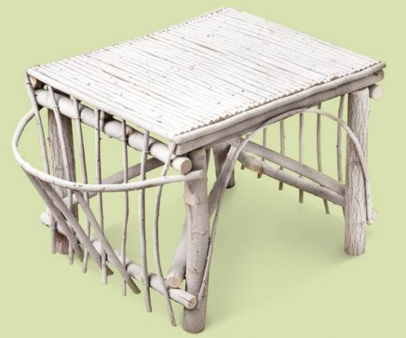 This whitewashed twig table will balance out bright, lively colors but will still provide eclectic detail to any cottage living space.