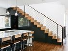 Minimal, walnut staircase w/removable baby (dog) gate.