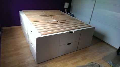 Ikea Hack: A captain bed with extra storage place. Base with 6 STUVA structures (60 x 50 x 64 cm) 3 on each side. one structure at the head. At the end of the bed, a STUVA structure without the back. For stability in the middle, added an Stuva structure (60 x 30 x 64 cm) without the back.On each side, to reach the 200 cm length required, put a Billy CD shelf, with saw off at 64 cm height. Once the structures fixed to each other, screwed the Sultan Ladde on top.